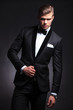fashion man posing in tuxedo