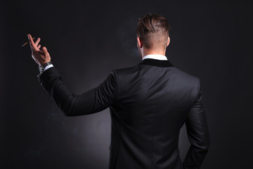 back view of business man with cigar