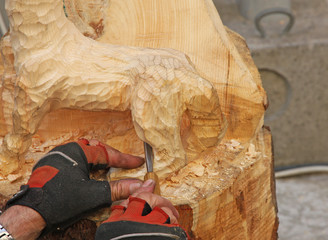 expert hands with gloves of a craftsman who works with wood