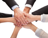 Businesspeople Stacking Their Hands Together