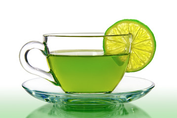 Green tea with lemon on a white background.