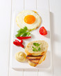 Grilled Leberkase sandwich with mustard and fried egg