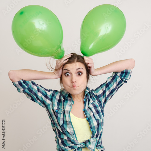 young woman with balloons