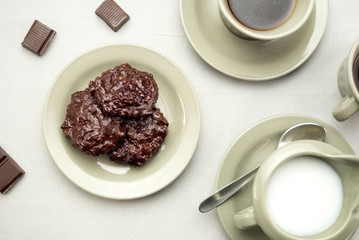 Chocolate cookies with coffee and milk