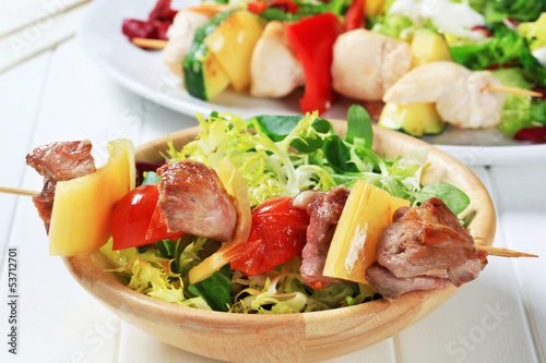Grilled pork skewer and spring salad