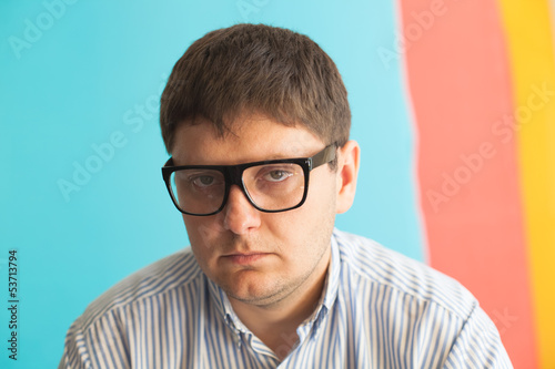 Upset man with glasses