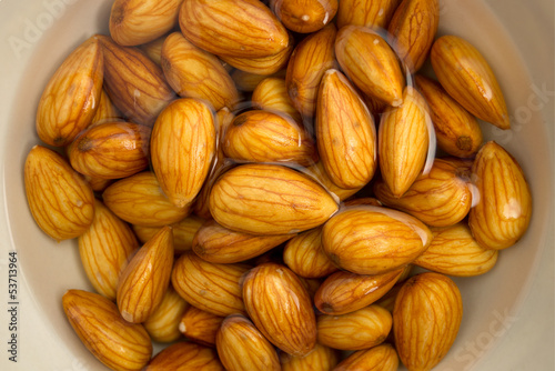 Closeup of almonds soaked in water