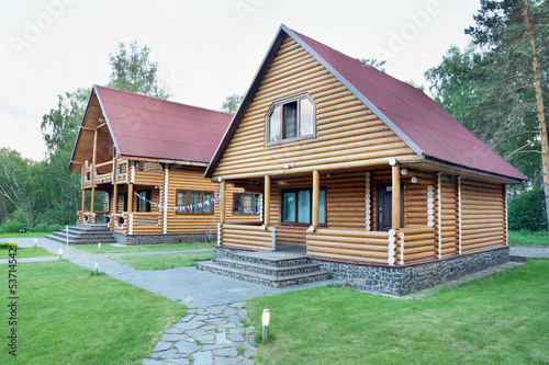 Two Wooden Houses Made of Logs