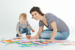 Mother and child are drawing against white background