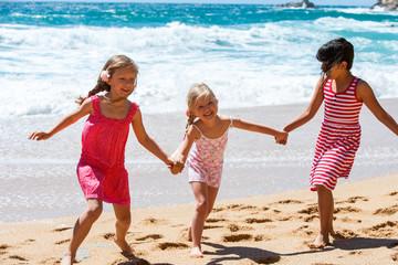 Threesome having fun at seaside.