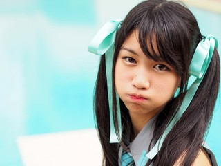 Pretty cosplay girl showing angry face