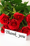 Thank you note and red roses