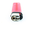 A used butane pink or red lighter - Pink or red lighter on white