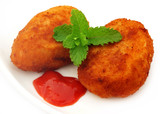 Potato chops with tomato ketchup and fresh mint leaves
