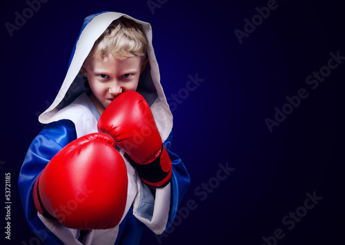 Boxing fighter boy portait on blue background - 53721185