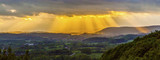 golden sunset at the  mountains of the saarland with dark rain c