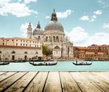 Fototapety Basilica Santa Maria della Salute, Venice, Italy and wooden surf