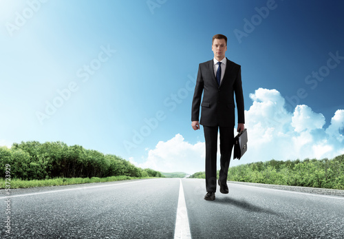 business man walking on the road