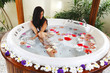 Pretty woman relaxing in jacuzzi
