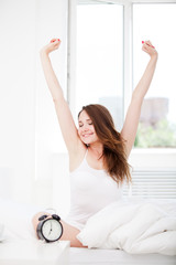 woman waking up and giving a stretch