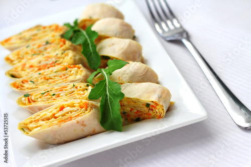 Rolls of Armenian lavash with onions, carrots and cheese