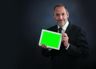 Businessman shows Tablet PC screen