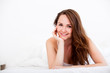woman lying in bed looking forward