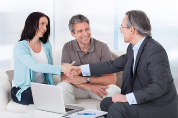 Consultant Shaking Hand With Woman