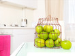 Green apples on the  white kitchen