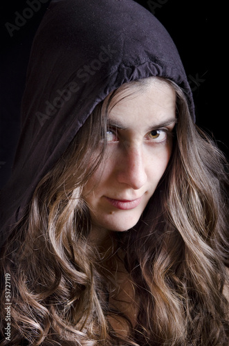 Mysterious girl portrait with urban style cap.