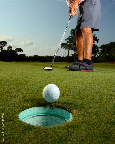 Golfer on a course golfing