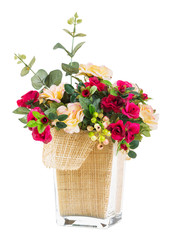 Bouquet of rose and jasmine in glass vase