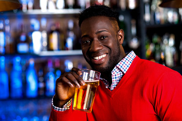 Guy drinking beer in a nightclub
