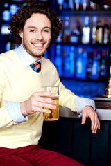 Young man holding a glass of beer
