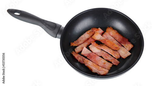 Fried bacon in frying pan  isolated on white