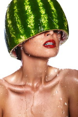 model with water-melon on head with water drops with red lips