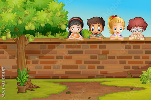 Children looking down the wall