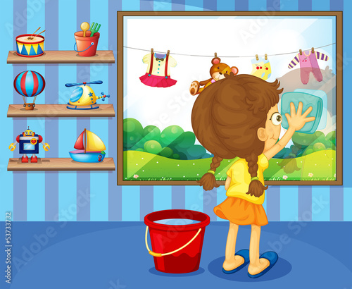 A girl cleaning her window pane