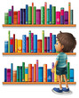 A boy in the library in front of the bookshelves