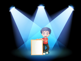 A boy with a framed signage at the stage