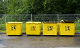 four old yellow trashcans