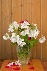 bouquet of white flowers on the wooden wall background