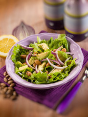 salad with avocado lettuce beans and onions, selective focus