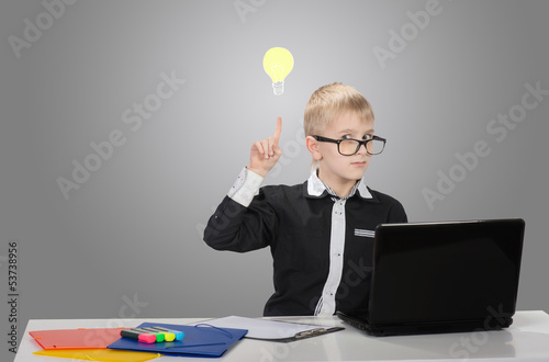 Funny boy with drawn electric bulb