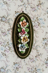 Ceramic flowers on the floral wall