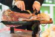waiter it cuts the ham