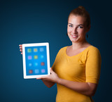 woman holding modern tablet with colorful icons