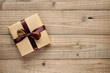 canvas print picture - Vintage gift box with bow on wooden background