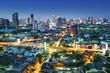 Traffic in modern city at night, Bangkok Thailand.