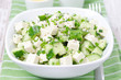 salad with cucumber, tofu, green onions and sesame seeds closeup